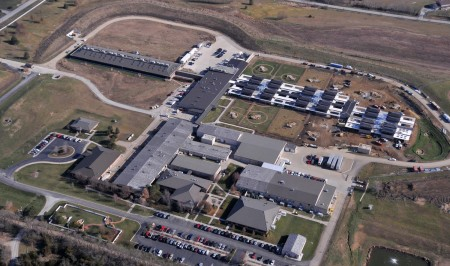 "Aerial view of the 170-acre Hill's Pet Nutrition Center. Along the top you can see the new feline and canine housing facilities. The canine one is surrounded by the ""Bark Park."""
